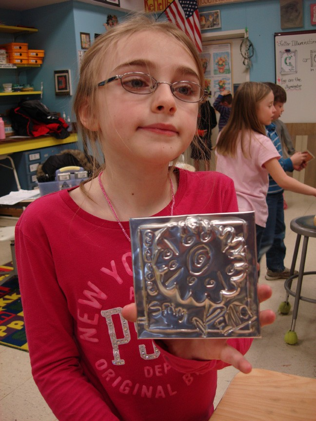 11Second grade girl with her tin 72